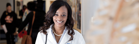 Female Africian American physician smiling.